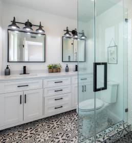 black and white powder room with patterned tiles